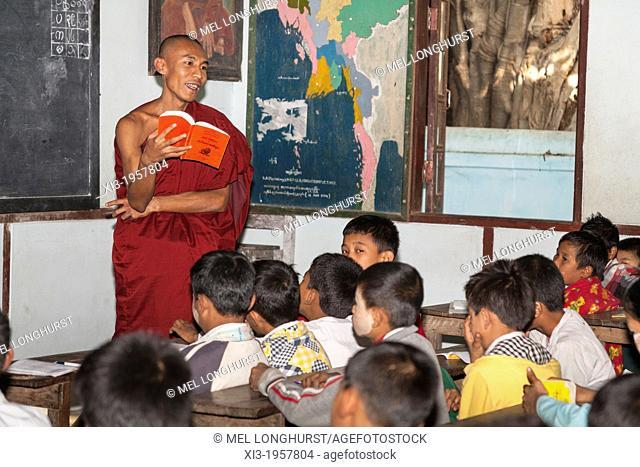 Buddhist monk teaching children, Mahagandhayon Monastic Institution, Amarapura, Mandalay, Myanmar, (Burma)