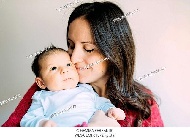 Mother holding her newborn baby girl