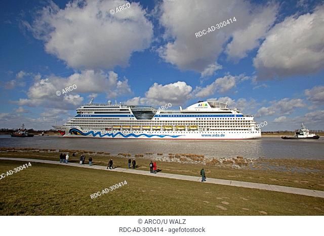 Cruise liner AIDAsol, ship passage on river Ems, Lower Saxony, Germany / tugboat
