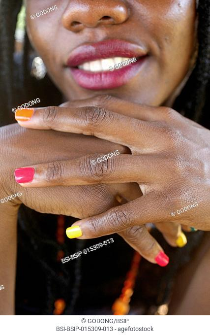 Young Ugandan woman with painted nails