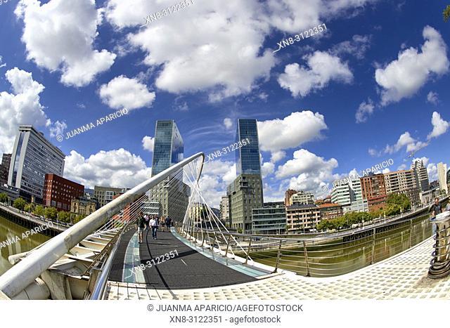 Zubizuri bridge by Santiago Calatrava and Isozaki Towers, Bilbao, Biscay, Basque Country, Euskadi, Euskal Herria, Spain, Europe