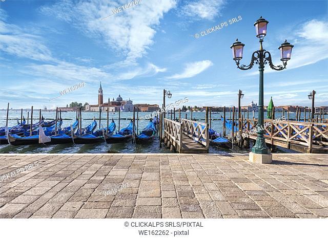 Gondolas of Venice in Riva degli Schiavoni with St. George's island in the background, Venice, Veneto, Italy