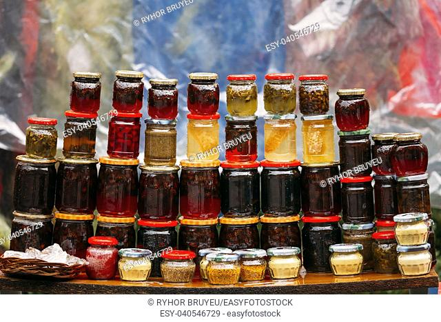 Various Jars With Sweet Tasty Yummy Jams Stading In Rows. Jam Made From Walnuts, Pine Cones, Walnuts, Honey, Pine Pollen. Traditional Healthy Cuisine