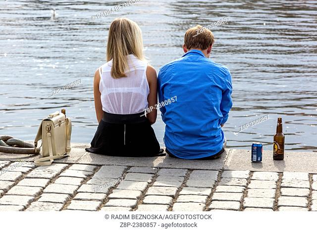 The pair on the river bank, Prague