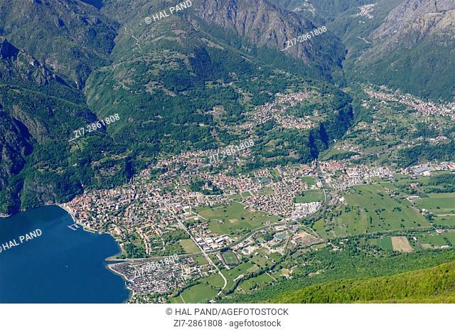 aerial shot, from a small plane, of Porlezza touristic village, shot on a bright springtime day in Lombardy , Italy