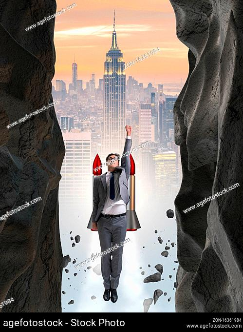 The businessman overcoming challenges in business concept