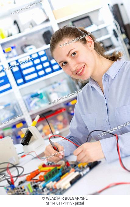 Student using a circuit board