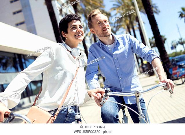 Couple with bikes in Barcelona