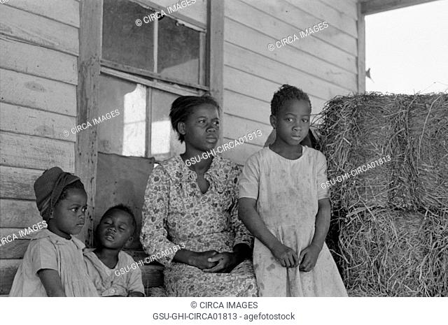 Sharecropper Family on Cabin Porch, New Madrid County, Missouri, USA, Russell Lee, May 1938