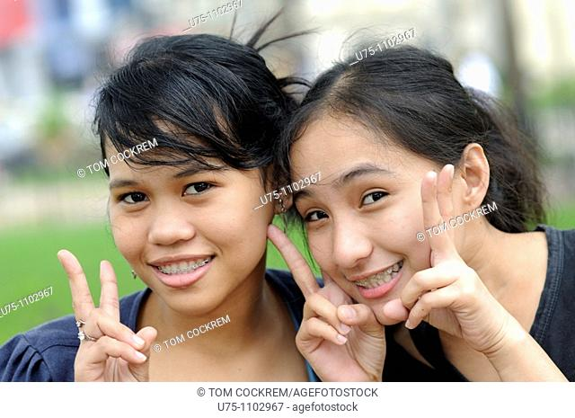 girls outside magellans cross cebu city philippines