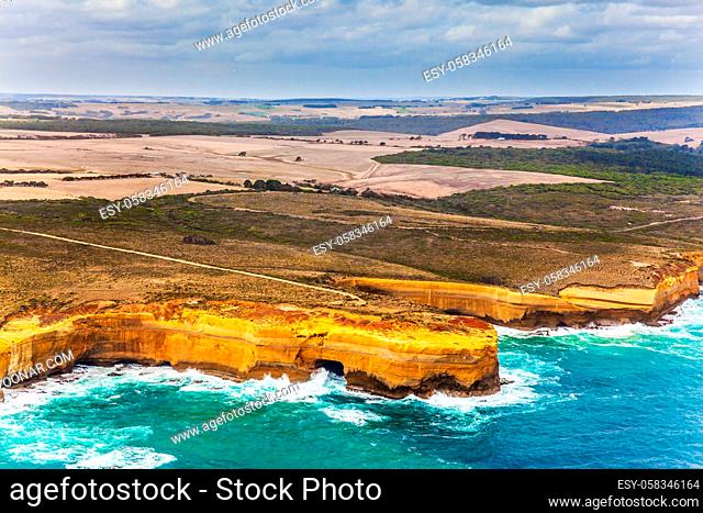 Australia. Scenic coastline. Great Ocean Road and the Twelve Apostles - group of limestone cliffs on Pacific coast. Picture taken from a helicopter
