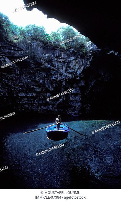 Melissani Cave, man on a bark Kefallonia, Ionian Islands, Greece