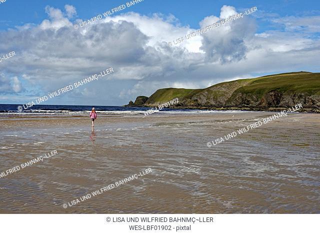 United Kingdom, Scotland, Highland, Sutherland, Bettyhill, girl walking at beach