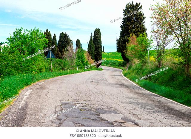 Winding road in green hills Tuscany, Italy