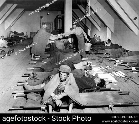 Hungarian Jews Lying on Cots after Removal from Nazi Concentration Camps to Facilities provided by US Army 121st Evacuation Hosp