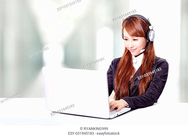 Friendly call center secretary consultant woman with headset telephone and pretty smile in office, asian model