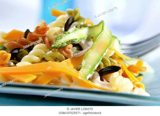 Fusilli with vegetable sheets, black olives and cream sauce