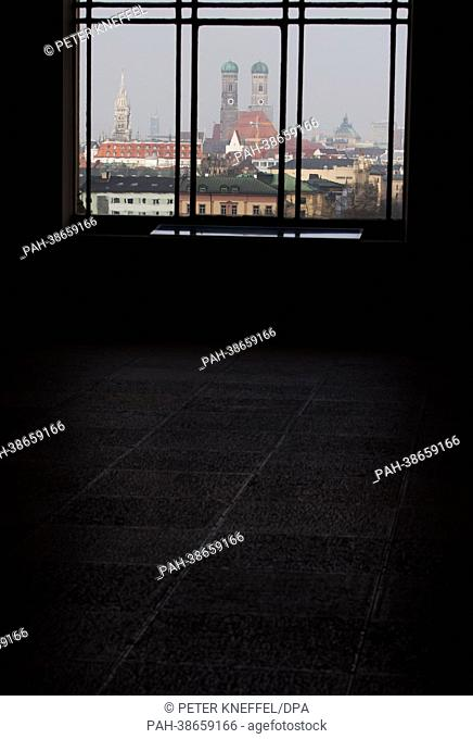 The steeples of St. Peter's (L) and the Frauenkirche are pictured from a window of the Bavarian state parliament in Munich, Germany, 08 April 2013