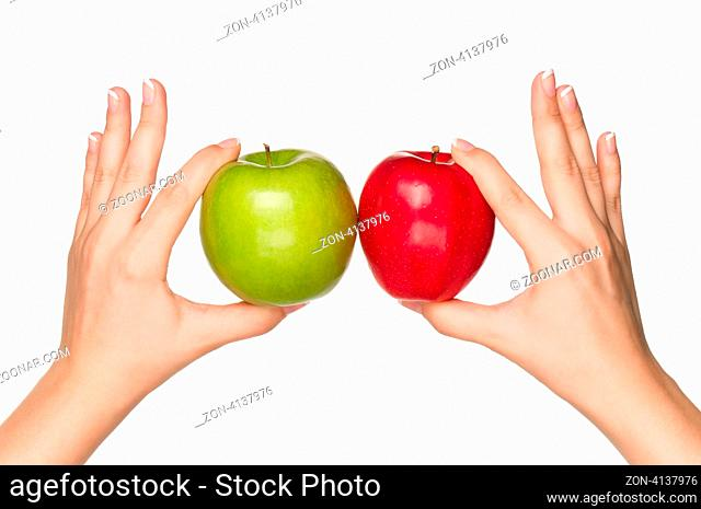Woman hands with green and red apples isolated on white background