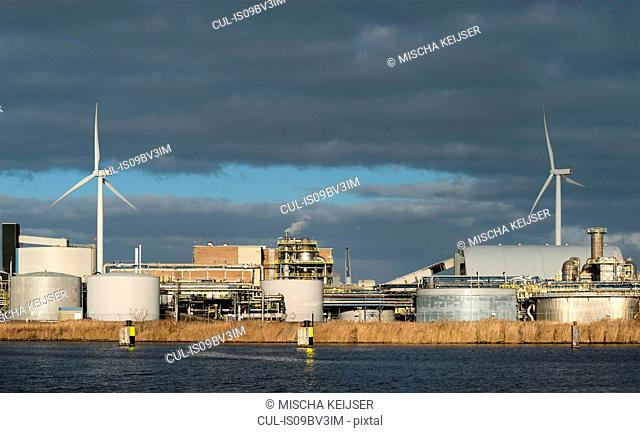 Chemical plant and wind turbines near Delfzijl harbour, Netherlands