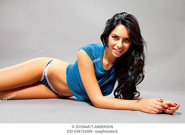 Attractive young woman posing on the floor