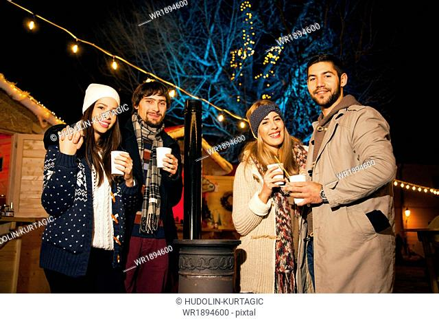 Group of friends having fun at Christmas Market