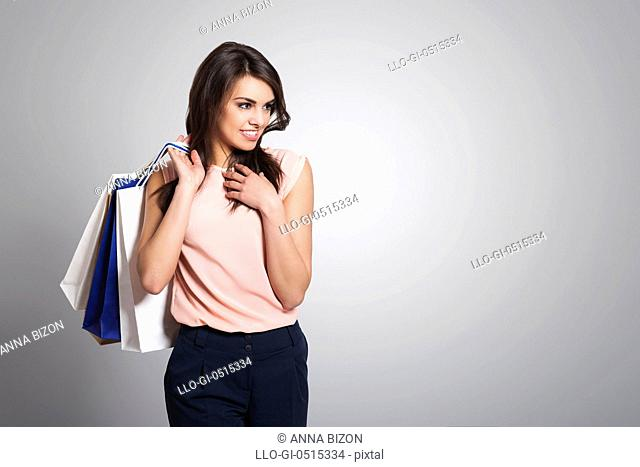 Beautiful fashionable woman with shopping bags. Debica, Poland