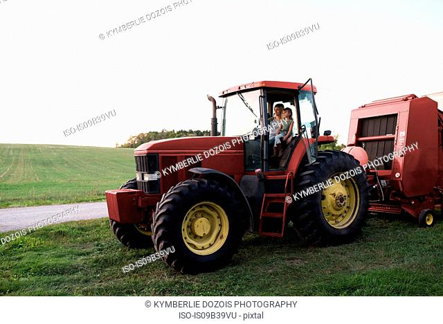 Mother and daughter sitting in tractor