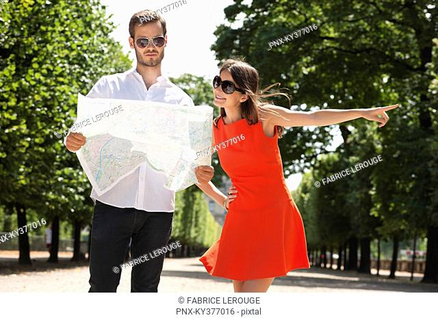 Man reading a map with a woman pointing, Terrasse De l'Orangerie, Jardin des Tuileries, Paris, Ile-de-France, France