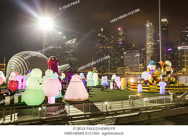 Singapore, Marina Bay, playing area for children with the towers of Financial District in background