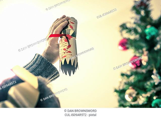 Person holding used christmas cracker