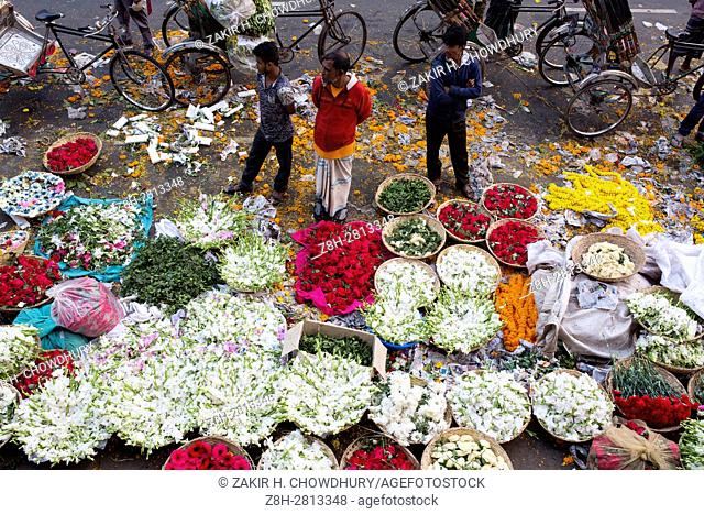 DHAKA, BANGLADESH - FEBRUARY 11 : People are busy with trade of flower in Shahbag flower market in Dhaka, Bangladesh on February 11, 2017