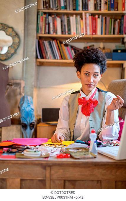 Designer working at desk in office