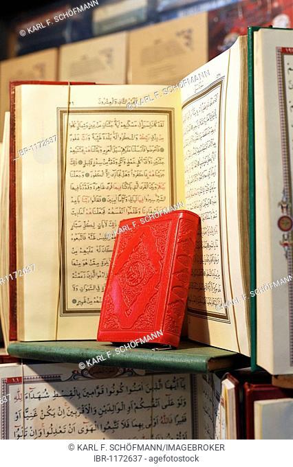 Little red book, pressed, in front of opened Koran, Arabic writing, book bazaar, Beyazit, Istanbul, Turkey