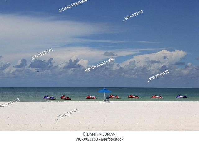 UNITED STATES OF AMERICA, MARCO ISLAND, Personal watercrafts float in the Gulf of Mexico along the magnificent white sand South Marco Beach on Marco Island