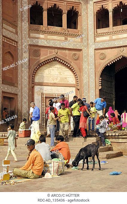 Street vendors at the Gate of Victory  'Buland Darwaza' Jami Masjid Mosque Fatehpur Sikri Uttar Pradesh India Dargah Mosque built 1569-1585 at the order of...