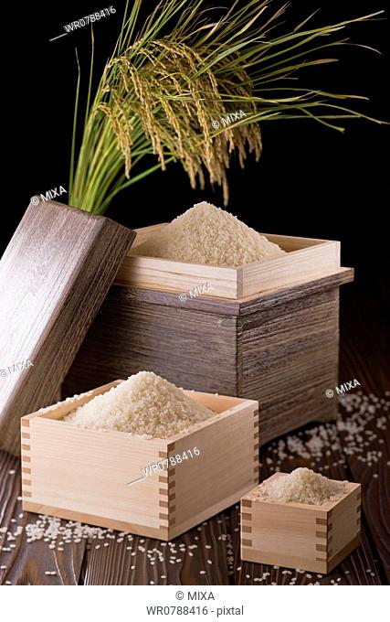 Rice in Box and Measuring Cup