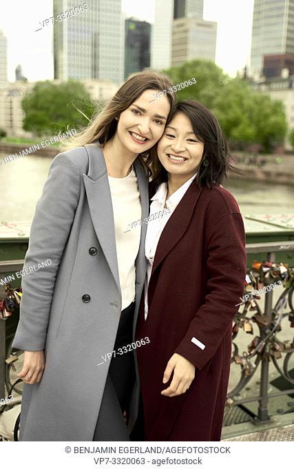 two women in city, head next to head, in Frankfurt am Main, Germany
