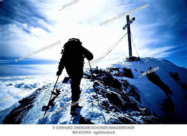 Mountain climber on the way to the peak, reaching the summit of Mt. Similaun, Tyrol, Austria, Europe