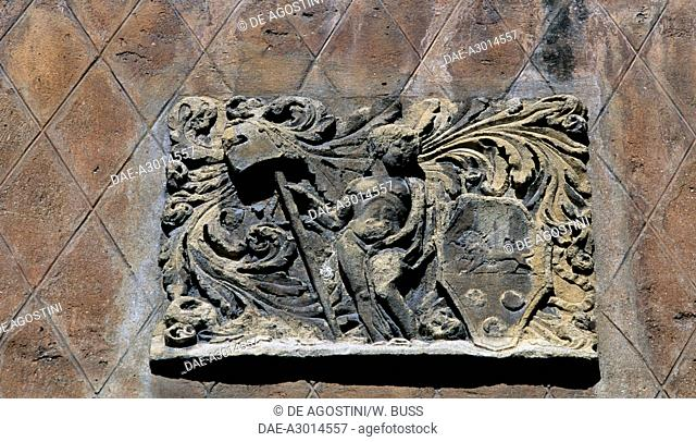 Bas-relief with coat of arms, detail on the facade of a palace, Via Roma, Padua, Veneto, Italy