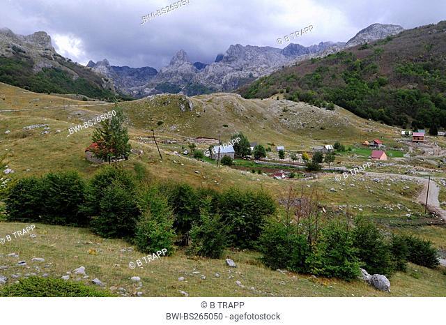 rough karst mountain landscape in the Prokletije mountains with single houses at the border to the Kosovo, Montenegro, Prokletije