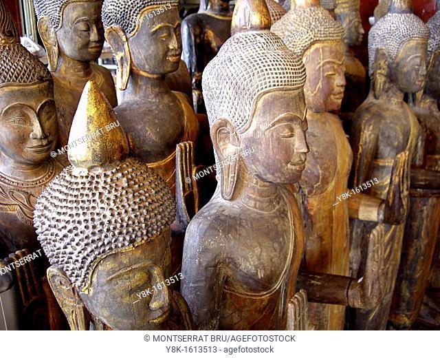 Standing wooden Buddhas at Phsar Thmey, Phnom Penh, Cambodia