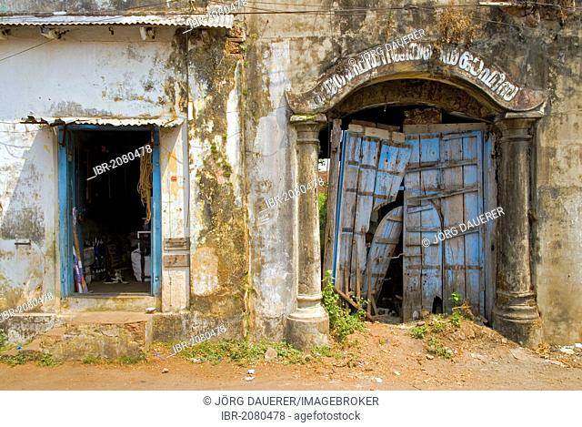 A facade with decaying blue doors in the Jewish quarter of Kochi in Mattancherry, Kerala, India, Asia