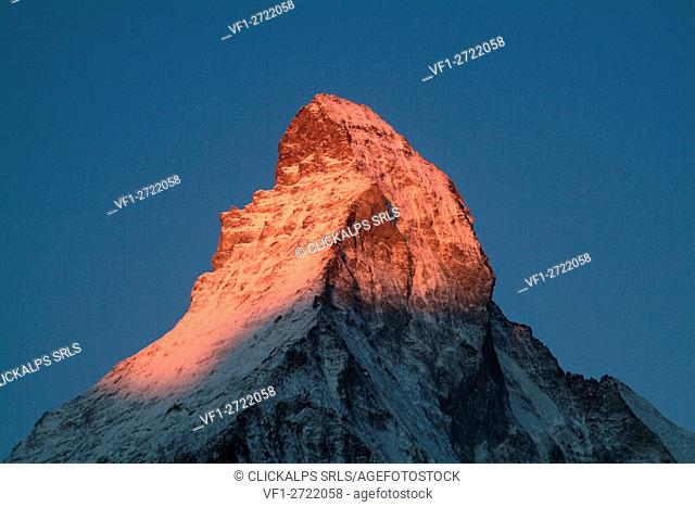 The wonderful pyramid of the snow-capped summit of the Matterhorn at sunrise, seen from the valley of Zermatt in the Canton of Valais in Switzerland Europe