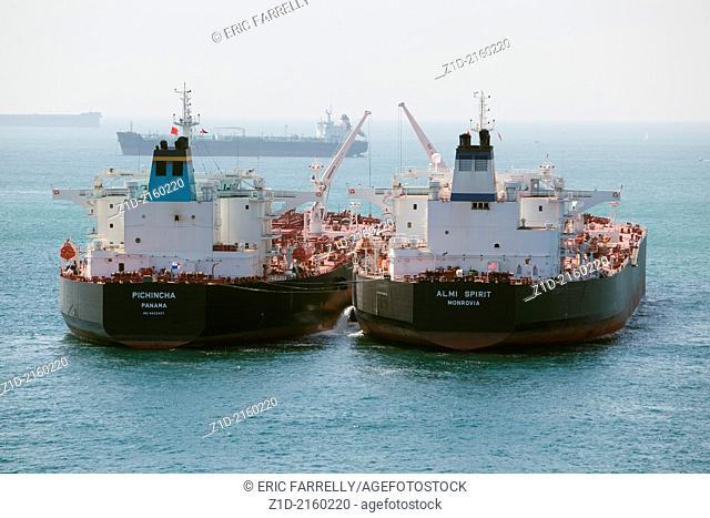 Tanker to tanker discharge. Tankers at Gibraltar