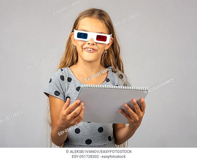 The girl in the colored 3D glasses, made using the anaglyph technology of the 3D glasses, looked into the frame