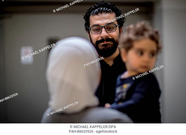 Syrian activist Khalid Rawas with his wife Abier Farhud and daughter Jasmin in Berlin, Germany, 01 March 2017. Many Syrian activists and oppositionists were...