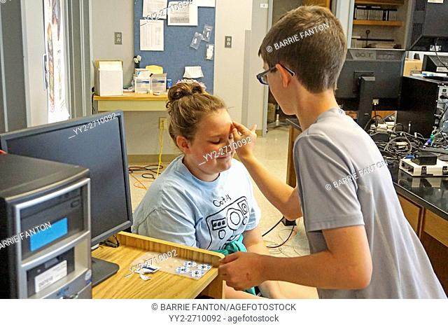 Middle Schoolers Doing Brain Wave Experiment, Houghton, New York, USA