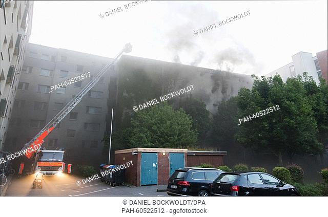 Smoke rises from a burning high-rise bunker in Hamburg,Germany, 04 August 2015. At least 21 people were injured after a fire and an explosion occurred in a...