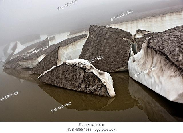 Chunks of ice calve near the summit of The Eyjafjallajokull Volcano in Iceland one year after the eruption. Lava broke through the Gigjokull Glacier causing...